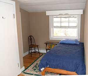 separate single bed in master bedroom