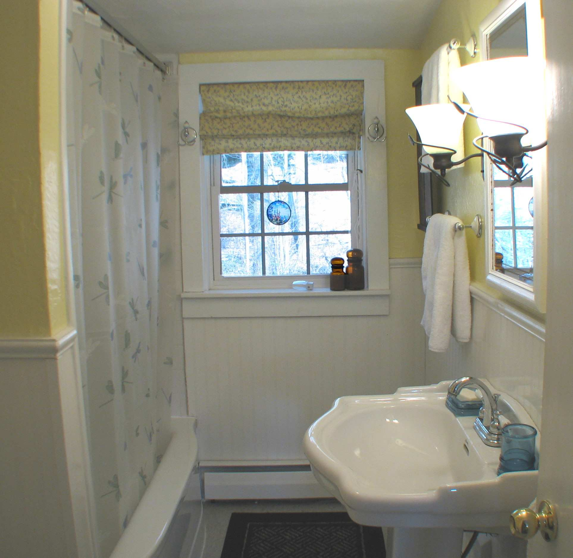 Full bathroom with tub shower and sink