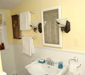 Full bath also has many hooks for hanging towles or clothes.