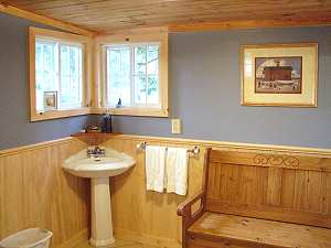 downstairs half bath with bench